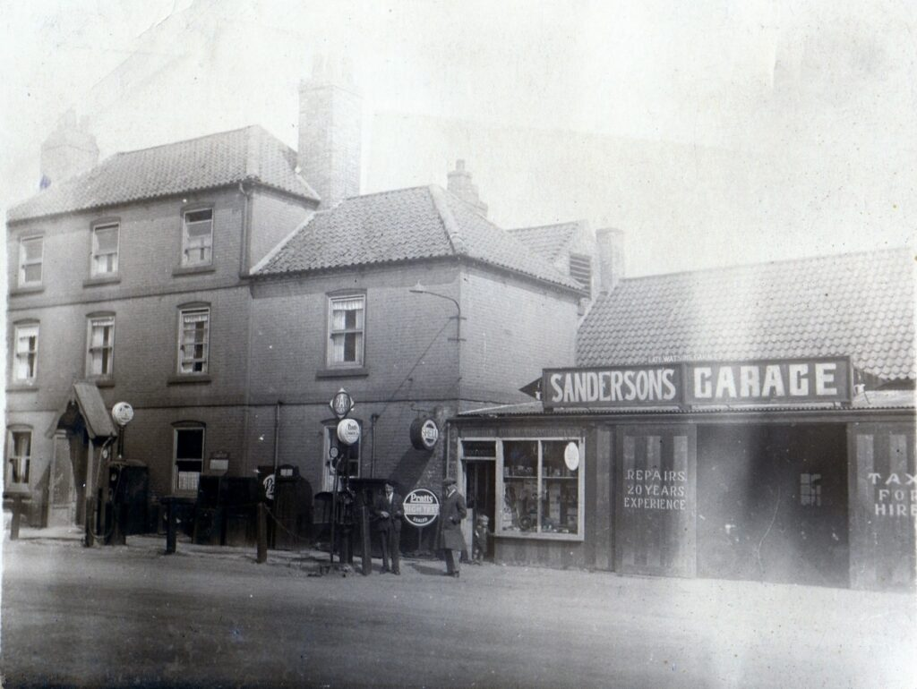 Sandersons' Garage around 1930. A family business mending cars and selling petrol.